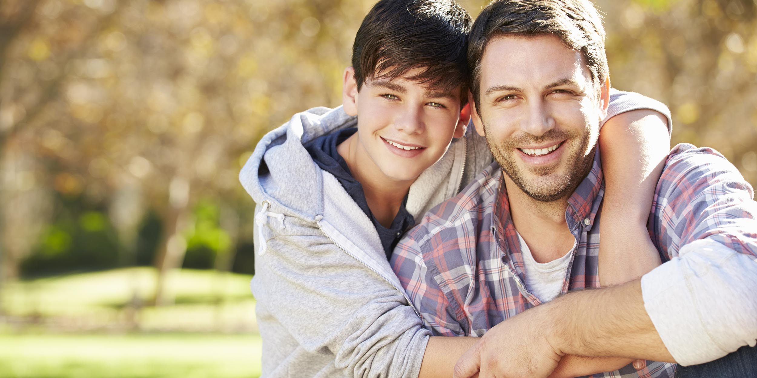 Portrait Of Father And Son In Countryside
