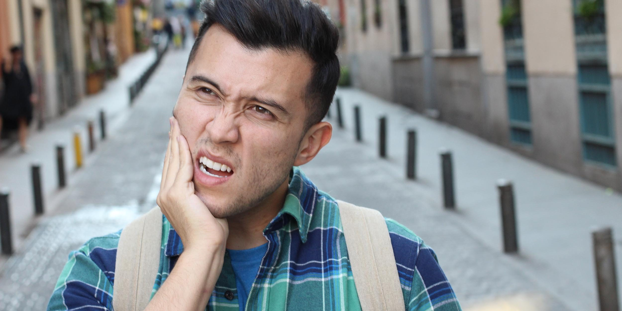 Unhappy man suffering from bruxism